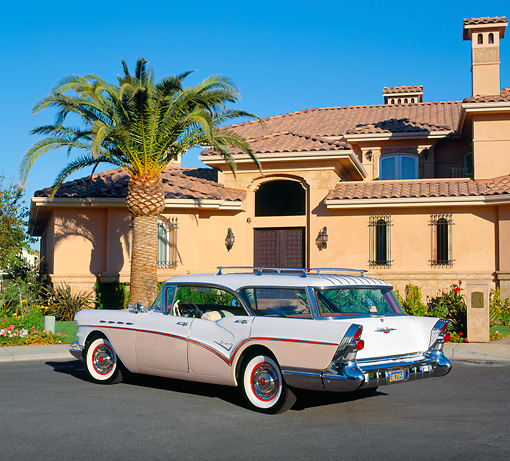 AUT 21 RK1549 02 © Kimball Stock 1957 Buick Century Estate Wagon Pink And White 3/4 Rear View On Pavement By Building And Palm Tree