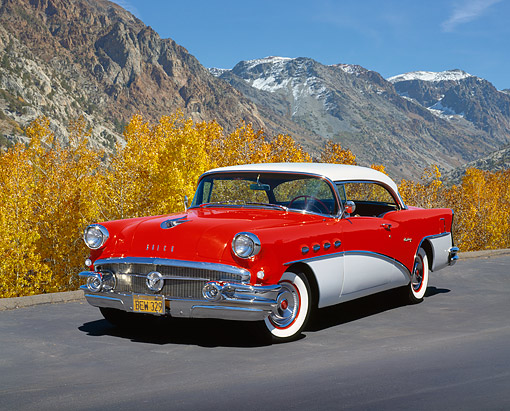 AUT 21 RK1551 04 © Kimball Stock 1956 Buick Century Red And White 3/4 Front View On Pavement Mountains