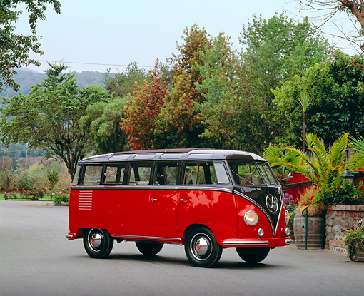 AUT 21 RK1613 02 © Kimball Stock 1953 VW Model 241 Deluxe Microbus Red And Black 3/4 Side View On Pavement By Plants And Trees