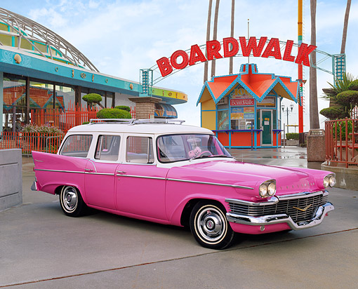 AUT 21 RK1684 01 © Kimball Stock 1958 Studebaker Station Wagon Pink 3/4 Side View On Pavement By Boardwalk