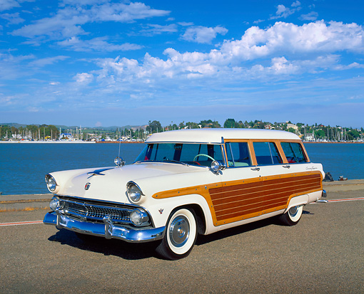 AUT 21 RK1714 02 © Kimball Stock 1955 Ford Woody Wagon White Front 3/4 View On Pavement By Water