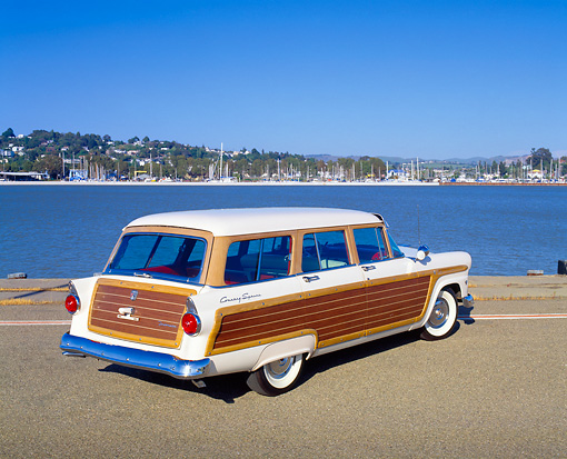 AUT 21 RK1716 01 © Kimball Stock 1955 Ford Woody Wagon White Rear 3/4 View On Pavement By Water