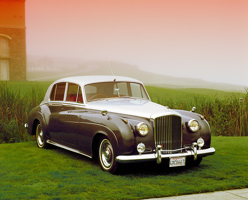 AUT 21 RK1780 02 © Kimball Stock 1958 Bentley Saloon S1 Silver And Gray 3/4 Front View On Grass In Fog