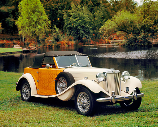 AUT 21 RK1796 03 © Kimball Stock 1952 MG TD Boattail Roadster Ivory 3/4 Side View On Grass By Water