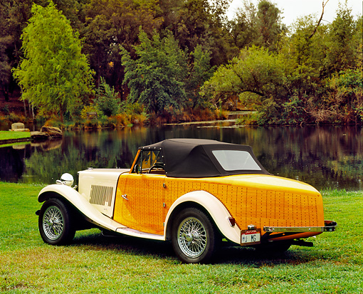 AUT 21 RK1797 04 © Kimball Stock 1952 MG TD Boattail Roadster Ivory 3/4 Rear View On Grass By Water