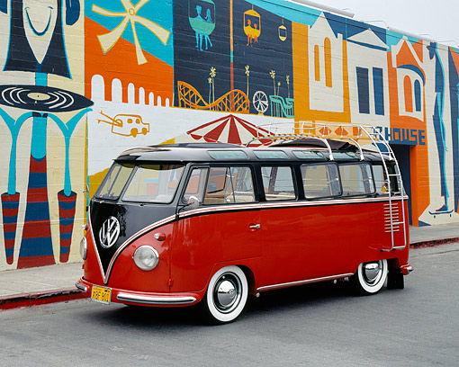 AUT 21 RK1813 05 © Kimball Stock 1956 VW Deluxe Bus Red And Brown 3/4 Side View On Pavement By Mural
