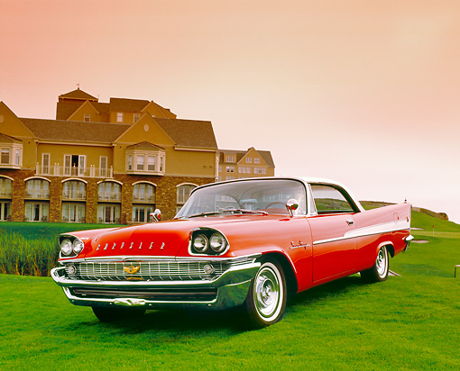 AUT 21 RK1884 01 © Kimball Stock 1958 Chrysler Saratoga Red And White 3/4 Front View On Grass By Mansion