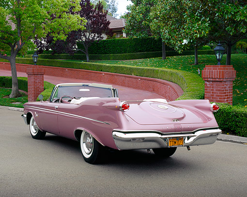 AUT 21 RK2019 01 © Kimball Stock 1959 Chrysler Imperial Crown Convertible Lavender 3/4 Rear View On Pavement By Brick Pathway