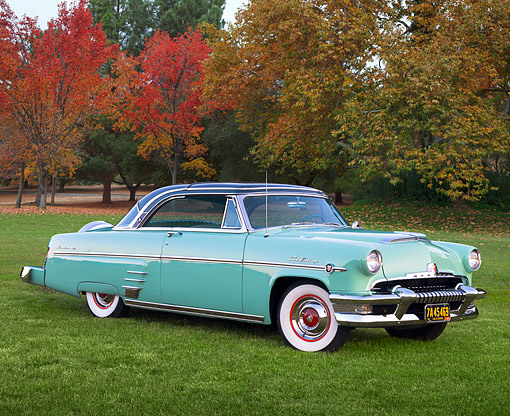 AUT 21 RK2025 01 © Kimball Stock 1954 Mercury Sun Valley Green 3/4 Side View On Grass By Autumn Trees