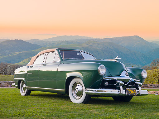 AUT 21 RK2130 01 © Kimball Stock 1951 Frazer Manhattan 4-Door Convertible Green Front 3/4 View On Grass By Hills At Sunset