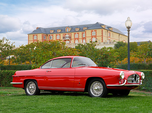 AUT 21 RK2133 01 © Kimball Stock 1954 Alfa Romeo 1900 SS Ghia Coupe Red 3/4 Side View On Grass By Mansion