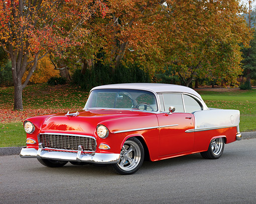 AUT 21 RK2334 01 © Kimball Stock 1955 Chevrolet Bel Air Red And White 3/4 Front View On Pavement By Autumn Trees