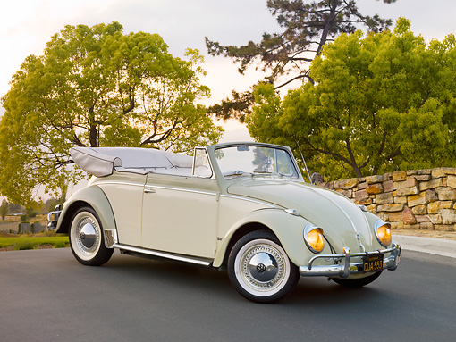 AUT 21 RK2404 01 © Kimball Stock 1958 Volkswagen Beetle Convertible White And Gray 3/4 Front View On Pavement By Stone Wall