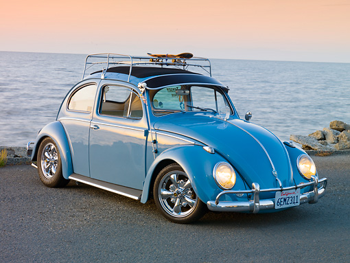 AUT 21 RK2421 01 © Kimball Stock 1958 Volkwagen Beetle Light Blue 3/4 Front View On Pavement By Ocean