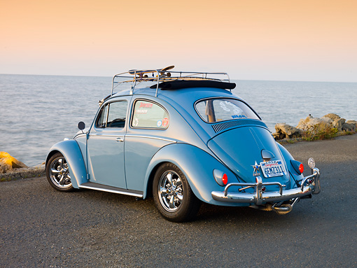 AUT 21 RK2424 01 © Kimball Stock 1958 Volkwagen Beetle Light Blue 3/4 Rear View On Pavement By Ocean