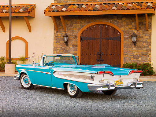 AUT 21 RK2448 01 © Kimball Stock 1958 Edsel Citation Convertible Turquoise 3/4 Rear View On Gravel By Building