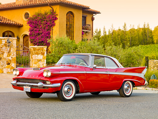 AUT 21 RK2457 01 © Kimball Stock 1958 Packard Red 3/4 Front View On Pavement By House