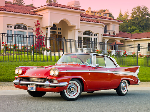 AUT 21 RK2459 01 © Kimball Stock 1958 Packard Red 3/4 Front View On Pavement By House