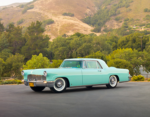 AUT 21 RK2482 01 © Kimball Stock 1956 Lincoln Continental Mark II Light Green 3/4 Front View On Pavement By Hills
