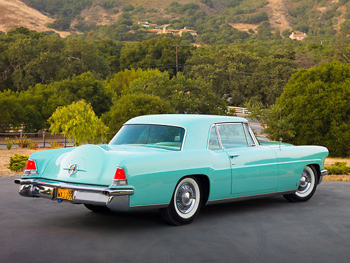 AUT 21 RK2484 01 © Kimball Stock 1956 Lincoln Continental Mark II Light Green 3/4 Rear View On Pavement By Hills