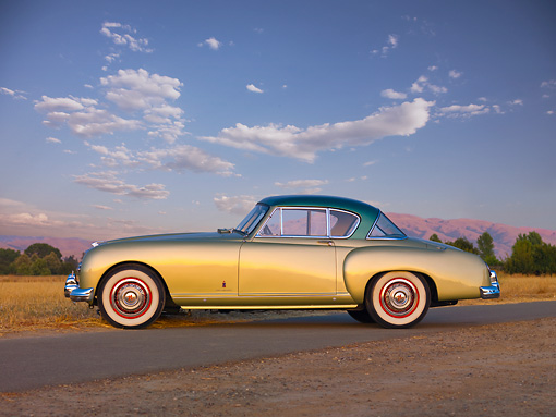 AUT 21 RK2496 01 © Kimball Stock 1954 Nash-Healey LeMans Coupe Green Profile View On Pavement By Field