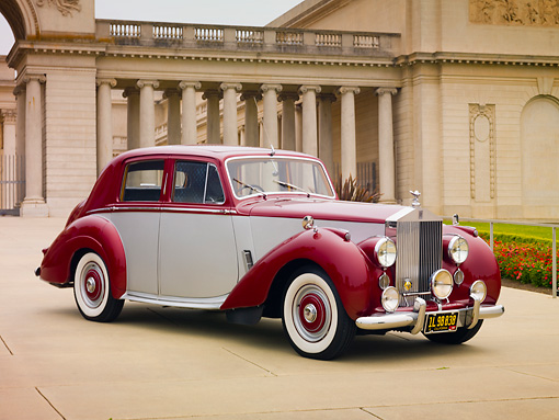 AUT 21 RK2507 01 © Kimball Stock 1954 Rolls-Royce Silver Dawn Silver And Maroon 3/4 Front View On Pavement By Building