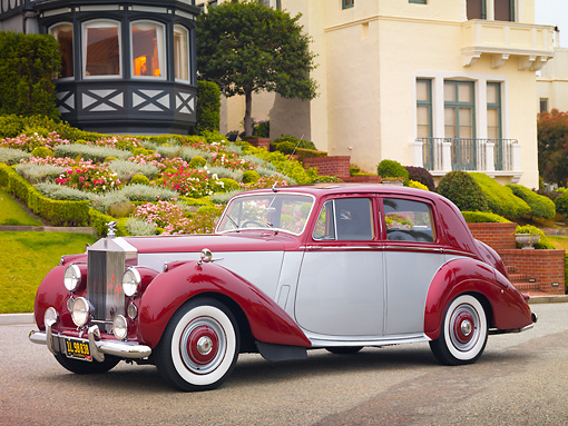 AUT 21 RK2512 01 © Kimball Stock 1954 Rolls-Royce Silver Dawn Silver And Maroon 3/4 Front View On Pavement By House