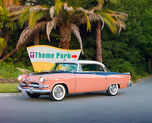 AUT 21 RK2518 01 © Kimball Stock 1955 Dodge Royal Lancer Pink 3/4 Front View On Pavement By Palm Trees