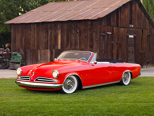 AUT 21 RK2532 01 © Kimball Stock 1953 Studebaker Commander Convertible Red 3/4 Front View On Grass By Barn