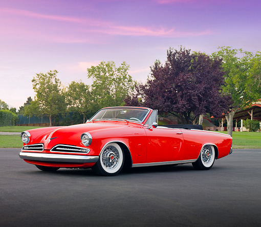 AUT 21 RK2534 01 © Kimball Stock 1953 Studebaker Commander Convertible Red 3/4 Front View On Pavement By Trees