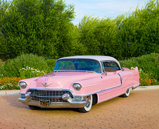 AUT 21 RK2539 01 © Kimball Stock 1955 Cadillac Coupe de Ville Pink 3/4 Front View On Pavement By Trees