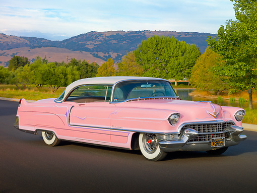 AUT 21 RK2542 01 © Kimball Stock 1955 Cadillac Coupe de Ville Pink 3/4 Front View On Pavement By Hills