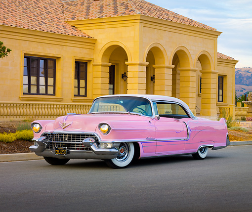 AUT 21 RK2546 01 © Kimball Stock 1955 Cadillac Coupe de Ville Pink 3/4 Front View On Pavement By House