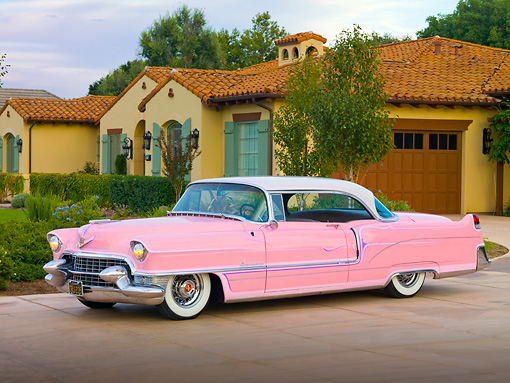 AUT 21 RK2548 01 © Kimball Stock 1955 Cadillac Coupe de Ville Pink 3/4 Front View On Driveway By House