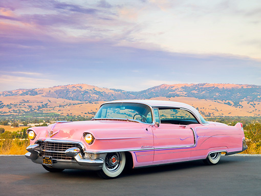 AUT 21 RK2551 01 © Kimball Stock 1955 Cadillac Coupe de Ville Pink 3/4 Front View On Pavement By Valley