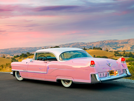 AUT 21 RK2554 01 © Kimball Stock 1955 Cadillac Coupe de Ville Pink 3/4 Rear View On Pavement By Valley