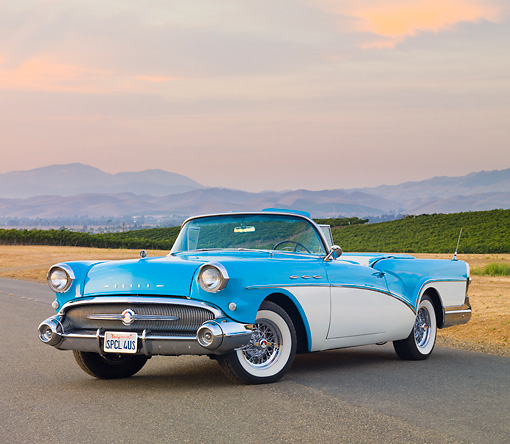 AUT 21 RK2563 01 © Kimball Stock 1957 Buick Special Convertible Turquoise And White 3/4 Front View On Pavement By Vineyard