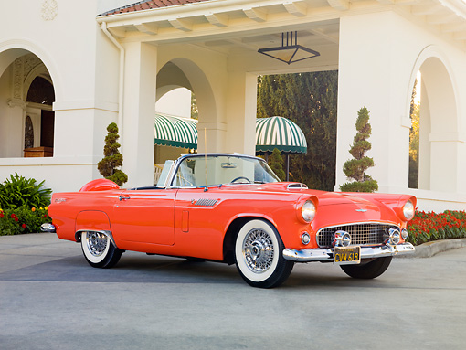 AUT 21 RK2570 01 © Kimball Stock 1956 Ford Thunderbird Convertible Coral 3/4 Front View On Pavement By Building