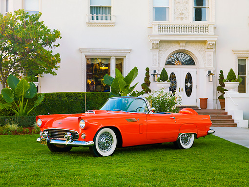AUT 21 RK2571 01 © Kimball Stock 1956 Ford Thunderbird Convertible Coral 3/4 Front View On Grass By Building