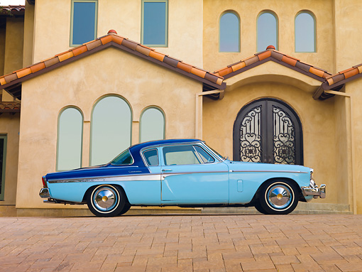 AUT 21 RK2588 01 © Kimball Stock 1955 Studebaker Commander Coupe Blue Profile View On Pavement By House