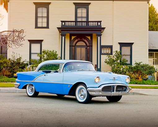AUT 21 RK2617 01 © Kimball Stock 1956 Oldsmobile Super 88 Blue On Road In Front Of A House