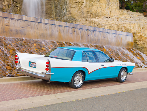 AUT 21 RK2635 01 © Kimball Stock Mercury Grand Marquis DeSoto Custom Blue And White 3/4 Rear View On Pavement By Waterfall