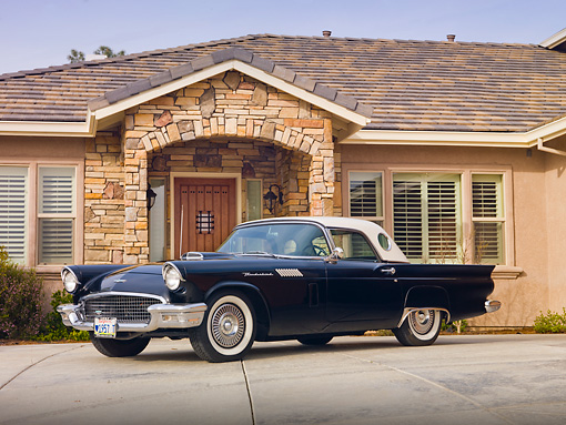 AUT 21 RK2653 01 © Kimball Stock 1957 Ford Thunderbird Black 3/4 Front View On Pavement By House