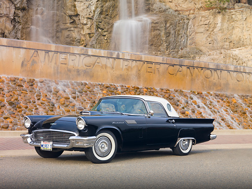 AUT 21 RK2655 01 © Kimball Stock 1957 Ford Thunderbird Black 3/4 Front View On Pavement By Waterfall