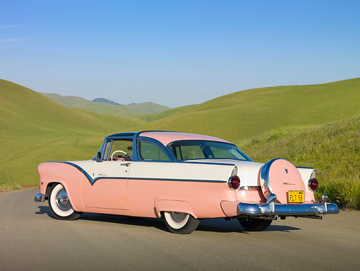 AUT 21 RK2679 01 © Kimball Stock 1955 Ford Crown Victoria Pink And White 3/4 Rear View On Dirt Road By Grassy Hills