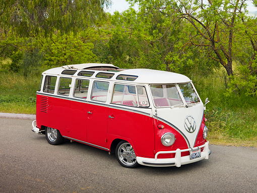 AUT 21 RK2691 01 © Kimball Stock 1959 Volkswagen 23 Window Microbus Raspberry And White 3/4 Front View On Pavement By Trees