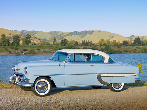 AUT 21 RK2698 01 © Kimball Stock 1953 Chevrolet Bel Air Blue And White 3/4 Side View On Gravel By Lake