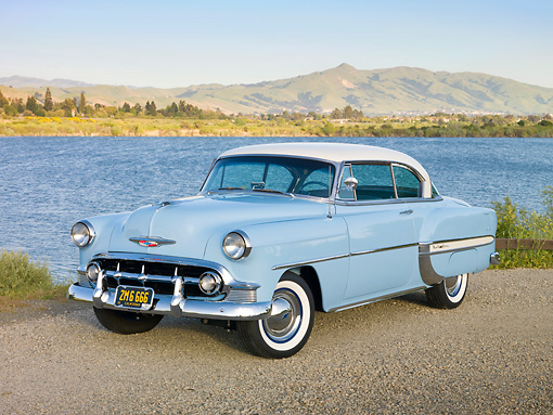 AUT 21 RK2702 01 © Kimball Stock 1953 Chevrolet Bel Air Blue And White 3/4 Front View On Gravel By Lake