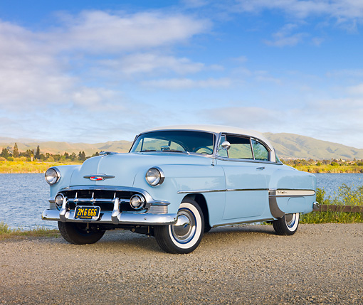 AUT 21 RK2703 01 © Kimball Stock 1953 Chevrolet Bel Air Blue And White 3/4 Front View On Gravel By Lake