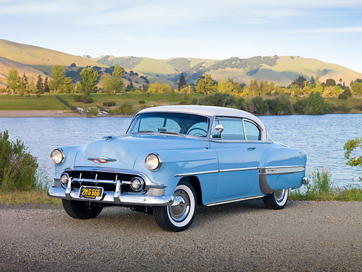 AUT 21 RK2704 01 © Kimball Stock 1953 Chevrolet Bel Air Blue And White 3/4 Front View On Gravel By Lake